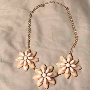 White and cream colored flower statement necklace.